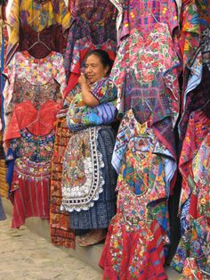 a shop owner, selling typical attire, in Guatamala.