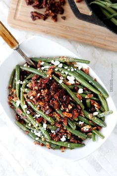 Dijon Maple Green Beans with Caramelized Pecans, Bacon and Feta. Not your mother's green beans. No offense to your mother.
