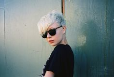 Long side-swept bangs, shaved pixie platinum hair.
