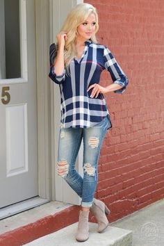 Head to your next meeting in style!Thistop is so classyand comfortable, you'll want to wear it on weekends too. Plaid print, v-neck top with 3/4 roll-tab sle