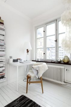 white with touch of timber, book tower, goatskin upholstery. Nice
