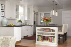Contemporary Kitchen with Built-in bookshelf, Large Ceramic Tile, One-wall, Farmhouse sink, Pendant light, specialty door