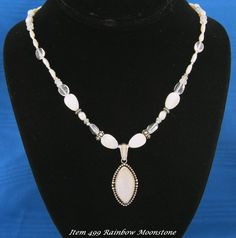 Check out this item in my Etsy shop https://www.etsy.com/listing/181637076/rainbow-moonstone-pendent-using-designer
