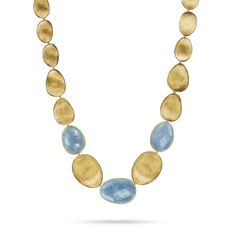 @marcobicego necklace in yellow #gold from the Lunaria high #jewellery collection, set with dark #aquamarines and engraved with the iconic Mulino finish.  See more at www.thejewelleryeditor.com