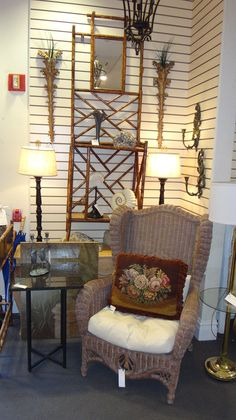 Tan high back wicker chair with cushion for a porch.  Like us on Facebook:  https://www.facebook.com/pages/The-Courtyard/419086284795890