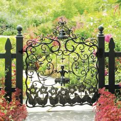MacKenzie-Childs - Mrs. Powers Garden Gate. I would love something like this at the entrance.