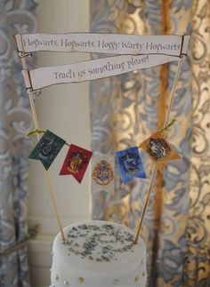 Hogwarts cake topper from Sorrel & Andy's Harry Potter Wedding. Sorrel owns and runs Ambience Venue Styling North  Lancashire.