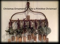 An antique garden rake re-purposed to hand Christmas ornaments from. Could also be used in the kitchen to hang long stem glasses from.