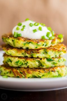 Zucchini Fritters are crisp on the edges with tender centers. These zucchini fritters are a kid-friendly family favorite. An easy summer zucchini recipe.   natashaskitchen.com
