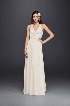 With a lace halter bodice and a chiffon skirt, this lace sheath wedding dress is simply beautiful. Add statement accessories for a look that's all your own. Exclusively at David's Bridal.