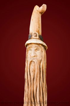 """Unique custom wizard chainsaw carving of a wizard. The chainsaw carving is 80"""" tall and made by Pioneer Cedar Living, a division of Pioneer Log Homes of BC."""