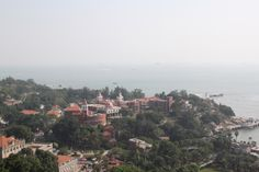Sunlight Rock (Riguangyan) is the highest point on Gulangyu Island in southern China's Xiamen, 92.68 meters above sea level. From this vantage point you can get a bird's eye view of the entire island. The climb up to the 40-meter-wide rock is leisurely and winds through some of the nicest scenery on Gulangyu Island, between mansions and ancient trees