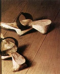 Clogs: detail from Jan Van Eyck's The Arnolfini Portrait, painted in 1434 in Bruges. #fashion #shoes