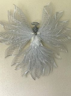 Angel made with Deco mesh Large Christmas home decor santa gifts halo silver ribbon bell ornament head wreathsnribbonsbydeb guardian Deco Mesh Crafts, Wreath Crafts, Christmas Projects, Christmas Home, Christmas Crafts, Christmas Ideas, Snowman Crafts, Wreath Ideas, Christmas Stuff