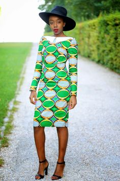 Fatou N'diaye completes an eyecatching look with black accessories and a classic red lipstick.