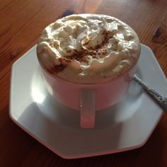 Latte with cream and cinnamon.