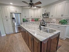 Traditional Kitchen with Hardwood floors, Raised panel, Kitchen island, Ceiling fan, L-shaped, Ceramic Tile, Flush
