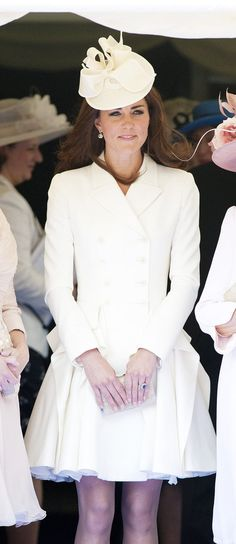 Kate Middleton, in a white Alexander McQueen dress, at the Order of the Garter service at St. George's Chapel at Windsor Castle today.