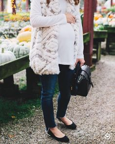 Maternity Style: Everything you need for #Fall: drop hem jeans, faux fur vest, a cozy tee & ballet flats (baby bump optional ) http://liketl.it/2sMMV