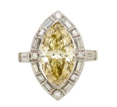A colored diamond solitaire ring  centering a marquise-cut brownish yellow diamond, weighing 4.85 carats, surrounded by baguette and brilliant-cut diamonds, the shoulders set with baguette-cut diamonds; mounted in platinum