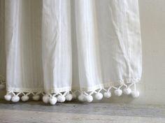 Des pompons aux rideaux