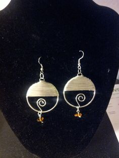 Silver wrapped circles with amber
