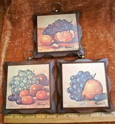 $8.25 USD on Etsy. Vintage kitchen fruit pictures plaques wood set of 3 by Homco. I only own the top one and a different one with different fruit (2 pairs, an apple cut in half and some strawberries).