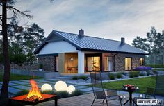 You'll want to cozy up in this warm home, with its modern fireplace and well-defined spaces. It's eco-friendly too! Small Bungalow, Modern Bungalow House, Bungalow Homes, Bungalow House Plans, Dream House Plans, Gable House, House Roof, Facade House, Simple House Plans