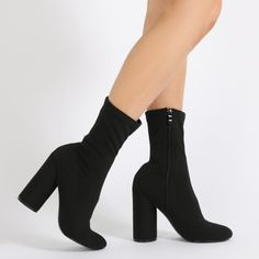 Sock it to ya! Sock fit stretch fabric ankle boots with a chunky block rounded heel. These booties sit high on the ankle with a rounded toe so go great with mini dresses. Wear these on your next shopping trip or dress em up for some 'quiet' drinks out with the girls.  Heel Height: 4.5\
