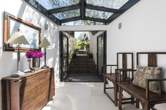 This beautiful glass roof creates an unusual entranceway into this Lambeth home