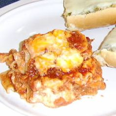 Rich, gooey ricotta and mozzarella are accented by tangy Cheddar. Layered with ground beef and garlicky tomato sauce.