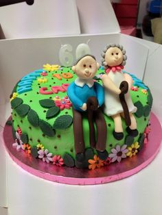 'Lady with walking stick' themed birthday cake