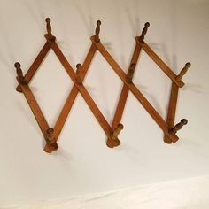 Check out this item in my Etsy shop https://www.etsy.com/listing/576185985/vintage-wooden-pegs-accordion-wall-hooks