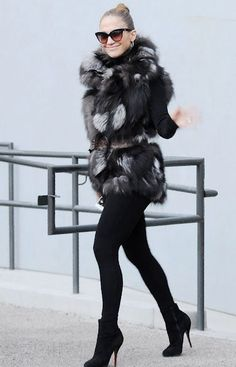Jennifer Lopez in a Gucci fur vest & Christian Louboutin booties