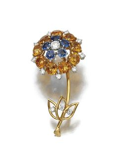 CITRINE, SAPPHIRE AND DIAMOND BROOCH, CARTIER, 1950S  Designed as a flower, set with circular-cut citrines and sapphires, highlighted with brilliant-cut diamonds, signed Cartier, Paris and numbered,French assay and maker's marks.