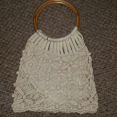 Vintage Crochet 1970s Handbag Wooden Handles The lining in this vintage handbag is perfect as shown in last picture. It doesn't even look used, but since this was handed down to me I'd say excellent preloved condition. This  vintage bag is so timeless and unique..be the only one in your friends circle with this wonderful gem! Bags Totes