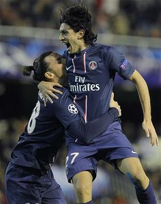 Paris Saint Germain midfielder Javier Pastore, right, embraces teammate Zlatan Ibrahimovic after scoring against Valencia during a Champions League match at the Mestalla stadium in Valencia, Spain.