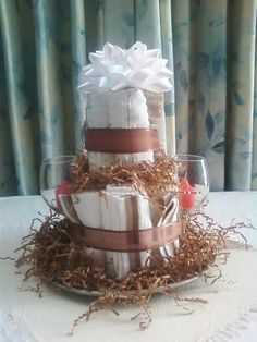 Candle Cake, a non-edible perfectly practical gift made with kitchen linens, 2 wine glasses and candles