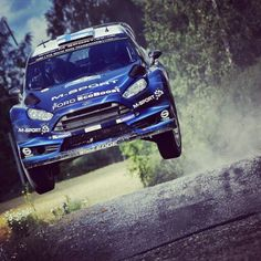 Mikko Hirvonen jumping at WRC Rally Finland 2014 on the brand new Ford Fiesta RC WRC