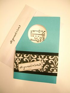 All you need is love card, black and white damask, keys, teal