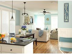 living room at olivia beach - love the color with the white painted cabinets and trim