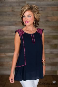 Devon Embroidered Top is a summer must have! This navy, crinkle top has charming pink embroidery around the back yoke, shoulders and along sides.