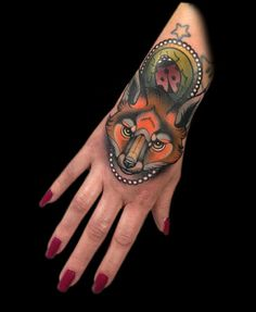 Mystical ladybug and fox tattoo by artist Myra Brodsky.