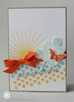 Eclectic. love the pop of orange in the ribbon and butterfly