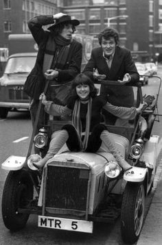 Fourth Doctor, Harry Sullivan & Sarah Jane Smith -  They are riding down a street in London, and the Doctor looks nervous because he can't drive his own car! ( Tom Baker, Ian Marter & Elisabeth Sladen)
