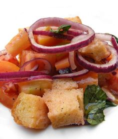 Panzanelle    Salad of tomato, red onion, basil, gaeta olive and bread.
