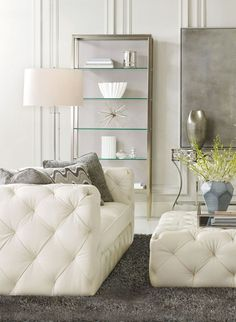 We love this Bernhardt Chelsea Sofa and Cocktail Ottoman in ivory leather! So elegant