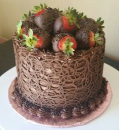 Chocolate cage cake with strawberries