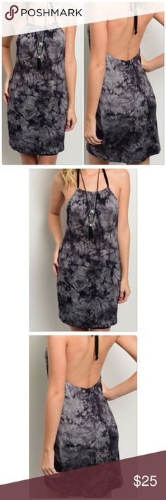 Black Grey Tie-Dye Halter Dress This halter dress features a tie-dye theme all over and self tie halter strap.  Country: USA Fabric Content: 95% RAYON 5% SPANDEX Size Scale: S-M-L Dresses