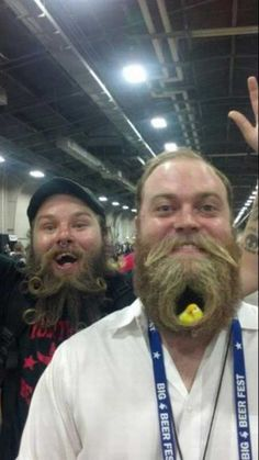 Odd Beards: And the winners of the wackiest facial hair for 2012 pose together! Bird in beard - booyah!